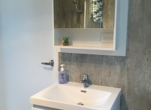 Vanity with mirror cabinet for additional storage
