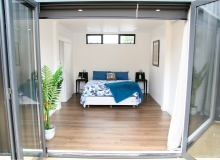 Master bed opens onto deck