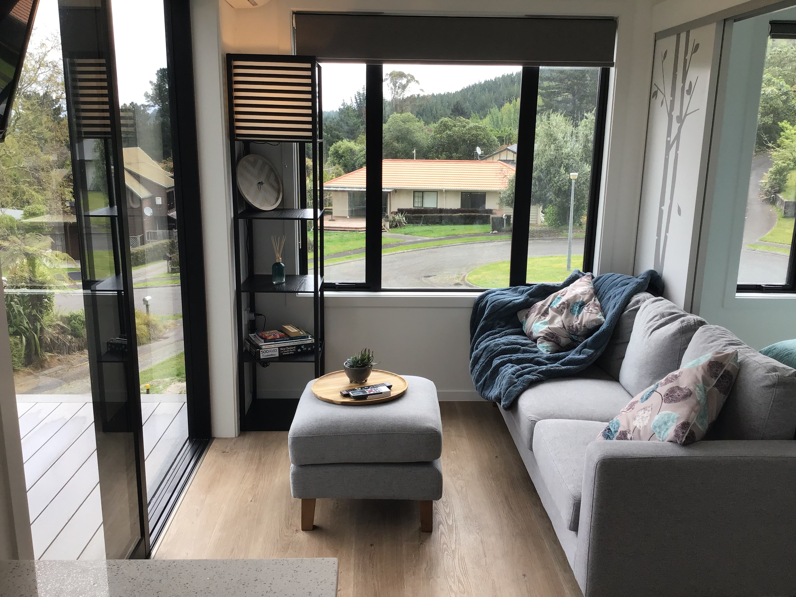 Living room with 3 seater couch. Level entry from deck