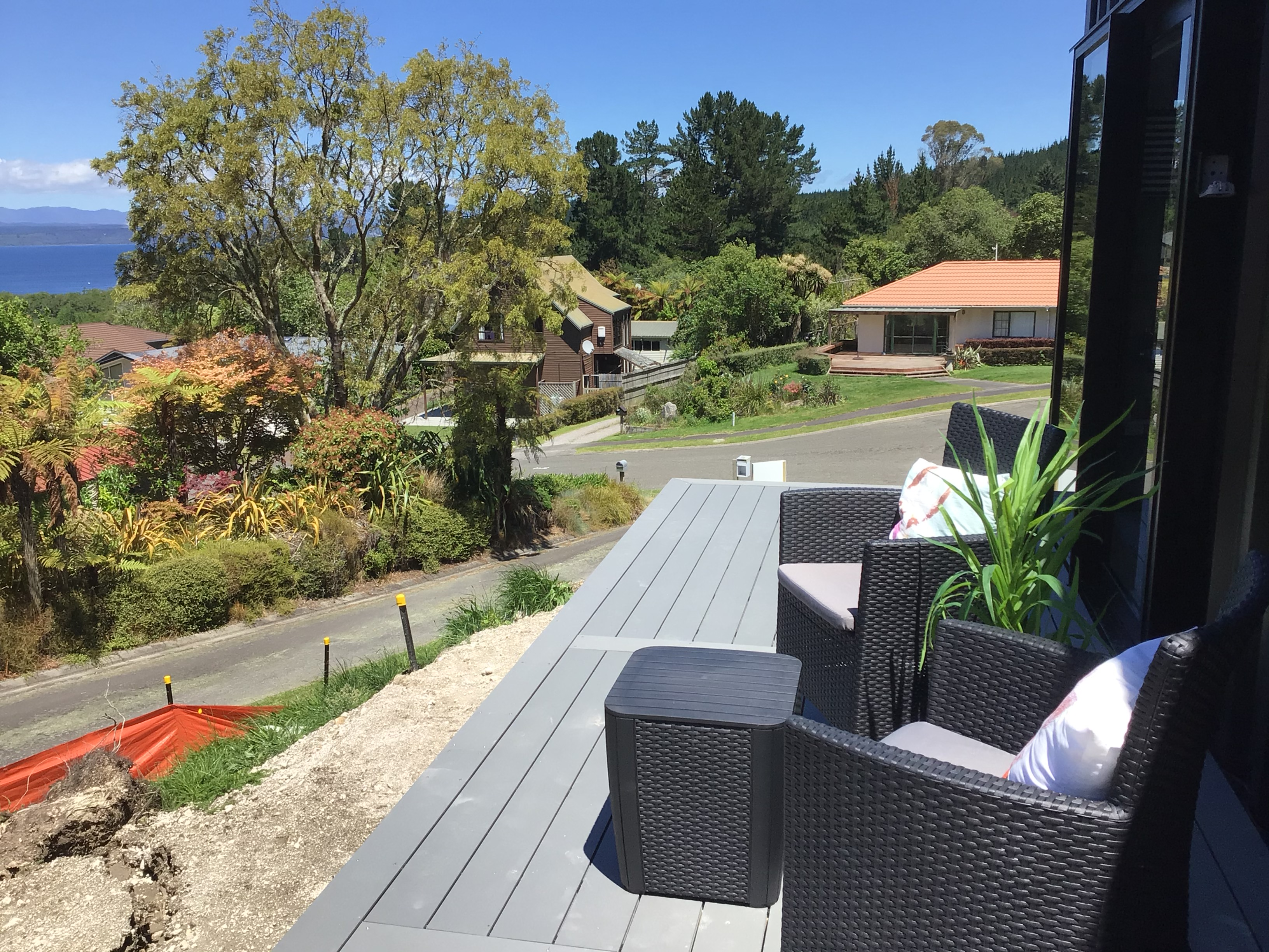 Sunny deck off kitchen/lounge area offers views over Lake Taupo