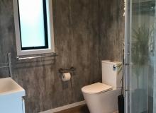 Generous sized bathroom with grab rails